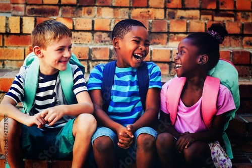 Staande foto Wanddecoratie met eigen foto Happy children sitting on steps