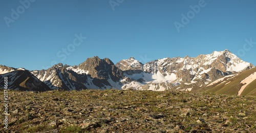 Tuinposter Blauwe jeans mountain tops with the remains of snow landscape background