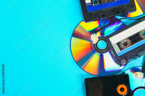 The concept of the evolution of music. Cassette, CD-disk, mp3 player. Vintage and modernity. Music support. - 211747003