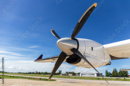 Tela  aircraft propeller blade and turboprop engines with airfield and blue sky backgr