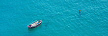 Small Boat On The Sea, Panoramic Aerial View,  In Guernsey