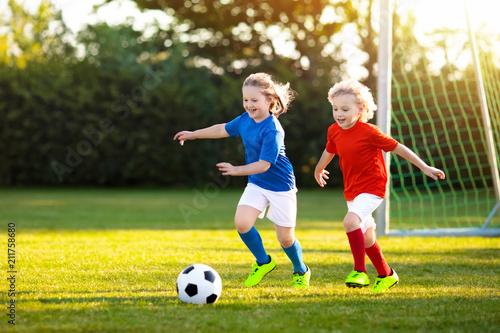 Fotografia, Obraz  Kids play football. Child at soccer field.