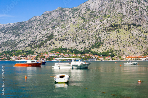 Deurstickers Bleke violet Nature landscape in boka-kotor bay with boats in the water, old european city Kotor surrounded mountains in Adriatic sea coastline, Montenegro