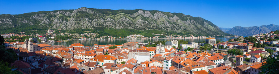 Panel Szklany Panoramic view from above on the old historical city Kotor with orange tile roofs, boka-kotor bay and mountains at Adriatic sea coastline, Montenegro
