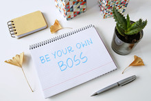 Be Your Own Boss Written In A Notebook On White Table