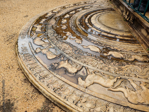 Fotografia, Obraz  The artistic ancient moonstone in Anuradhapura ancient city, Sri Lanka