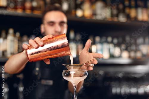 Fotografie, Obraz  Cocktail Bar. Bartender Making Cocktails, Pouring Drink In Glass