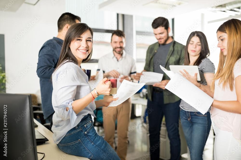 Fototapeta Business team going through some paperwork in office