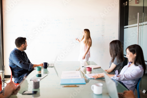 Fototapeta Young woman giving business presentation obraz