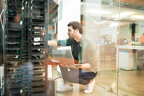 Network administrator in server room Canvas Print