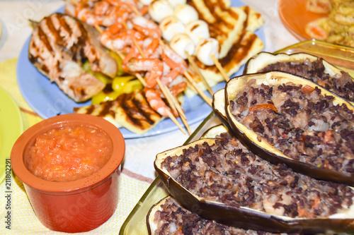 Greek meze a lot of food sauces skewers seafood shrimp fish mussels eggplant meat