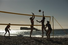 Silhouette Of Female Volleyball Players Playing Volleyball