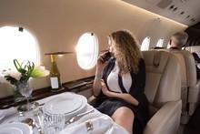 Businesswoman Looking Through ...