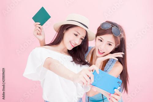 Fotografie, Obraz  two travel woman selfie happily