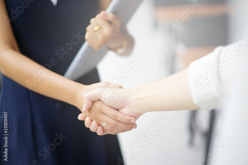Obraz na plátně close up investor businessman handshake with partner vendor,collaboration of two ceo leader hand shake for agreement or deal financial cooperative concept