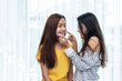 Two Asian women touching chin and playing with together. People and lifestyle concept. LGBT pride theme.