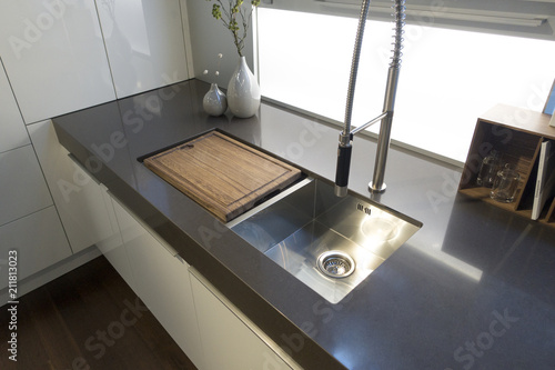kitchen sink with wood cutting board over left sink home ...