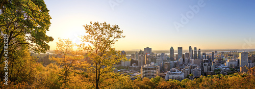 Montreal, Canada – 21 May 2018. Beautiful golden sunrise over the Montreal city. Amazing panorama of Montreal downtown skyline in the morning hours. Golden sun light view from Mont-Royal park.