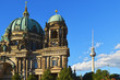 Facade of the Berlin Dome at the Lustgarten and the Berlin TV Tower in the downtown of Berlin in the evening sun.