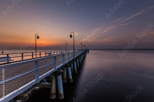 Fototapety, obrazy: Amazing colorful sunrise over the pier in Gdynia Orlowo. Sunrise over the sea.