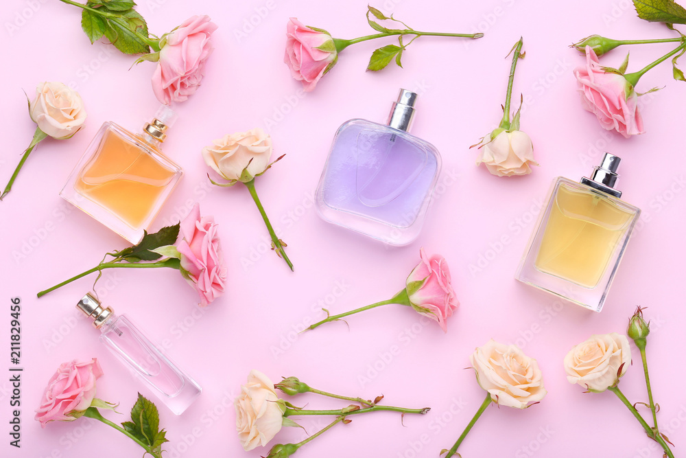 Fototapety, obrazy: Perfume bottles with flowers on pink background