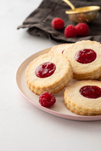 Traditional Christmas Linzer Cookies With Sweet Jam On Plate, Closeup, Copy Space.