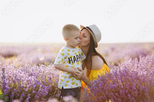 Young Woman In Yellow Dress Walk On Purple Lavender Flower Meadow