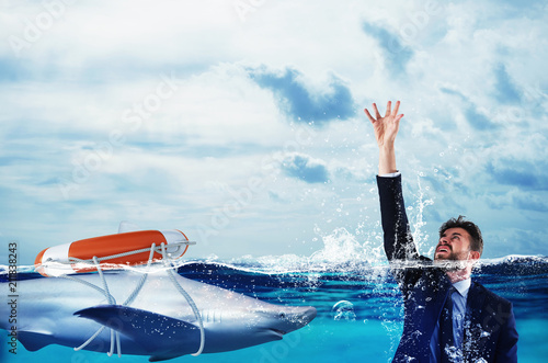 Businessman is likely to drown. Help with deception concept Wallpaper Mural