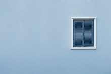 Blue Wall Of The House With A Closed Window Right And Details.