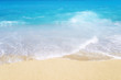 Top view of sandy beach with blue turquoise water and waves. Summer and holiday.