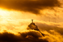 Corcovado Mountain With Christ The Redeemer Statue In Clouds On Sunset In Rio De Janeiro, Brazil