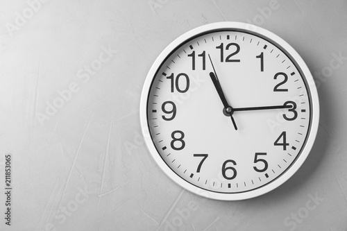 Fotografia Modern clock on grey background, top view. Time management