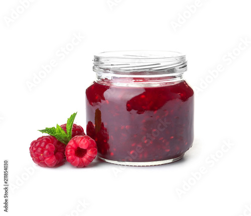 Jar with delicious raspberry jam on white background Canvas Print