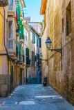 Fototapeta Uliczki - View of a narrow street in the historical center of Palma de Mallorca, Spain