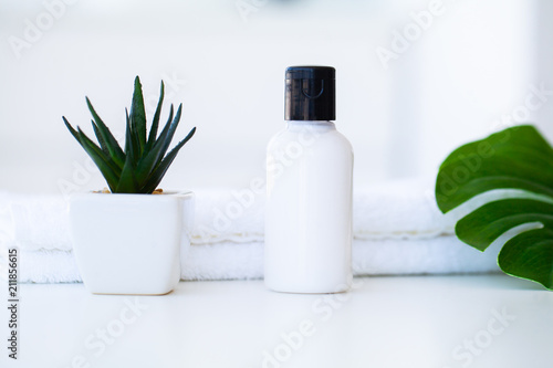 Poster Spa Wellness Products and Cosmetics. Herbal and mineral skincare. Jar of cream, white cosmetic bottles. Without label. Spa Set with soap and white towe