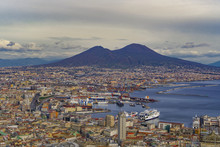Panoramic City View Over Seaport Of Napoli With Ships And Mount Vesuvius Volcano, Seen From Sant Elmo Castle, Naples, Campania