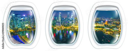 Staande foto Aziatische Plekken Porthole windows interior on marina bay financial district of Singapore. Asian skyscrapers reflected on the harbor by night. Scenic flight above Singapore skyline. Night aerial scene white background.