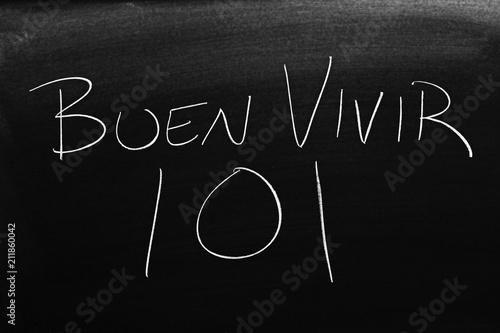 Photo  The words Buen Vivir 101 on a blackboard in chalk