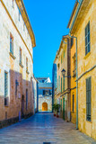 Fototapeta Uliczki - View of a narrow street in the old town of Alcudia, Mallorca, Spain