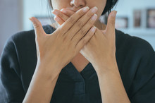 Asian Woman Covering Her Mouth And Smell Her Breath With Hands Upter Wake Up,Bad Smell