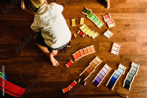 Fotografie, Obraz  Children playing and learning with montessori color tablets