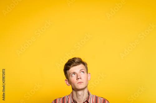 uncomprehending bewildered puzzled perplexed wondering man looking upwards Fototapeta