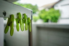 Closed Up Green Clothespin On Silver Metal Cloth Rack