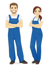Man And Woman In Blue Overalls