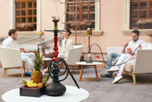 Shisha With Fruits On Table In...