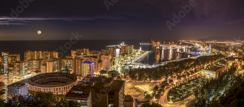 Fotografie, Obraz  Night cityscape of Malaga city with the mediterranean sea and the port in the background