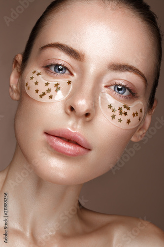 Canvas Print Beautiful fresh girl with cosmetic patches under the eyes, perfect skin and natural make-up
