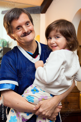 Fotografie, Obraz  Downs Syndrome Man Holds His Great Niece