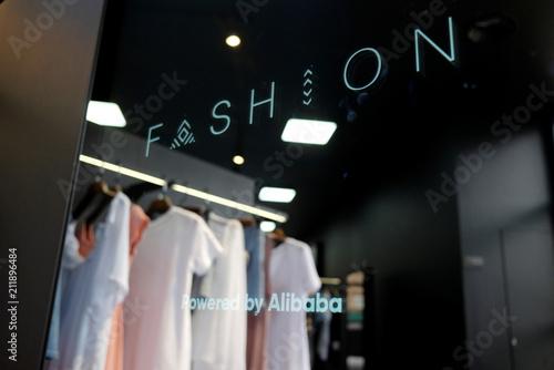 A mirror showcases Alibaba's FashionAI technology at a pop