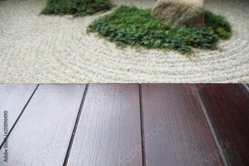 Foto auf AluDibond Zen-Steine in den Sand japanese zen stones garden with wood space background